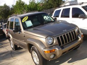 2004_jeep_liberty_limited_gold_in_palm_harbor_florida_100645220869495304